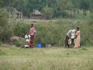 Villagers carry water great distances from dirty water holes