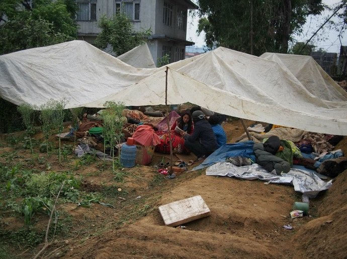 Families in makeshift shelters on Sunrise Farm.