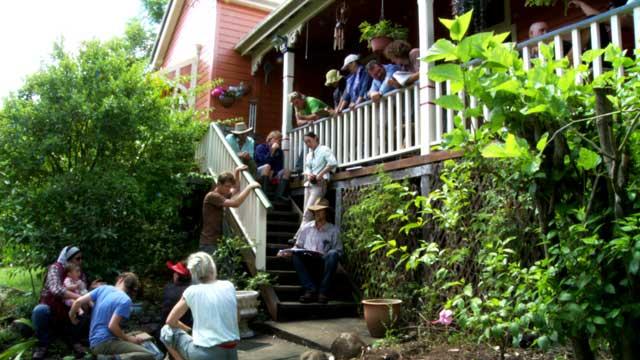 Geoff Lawton, center, designs a backyard system