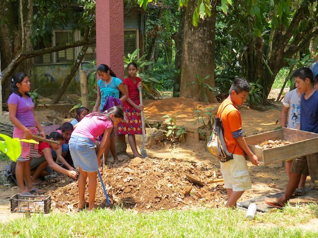 Kids in Casa Guatemala in Rio Dulce Helping to Clean Soil of Plastic Packaging They'd Thrown on the Ground (Emma Gallagher)