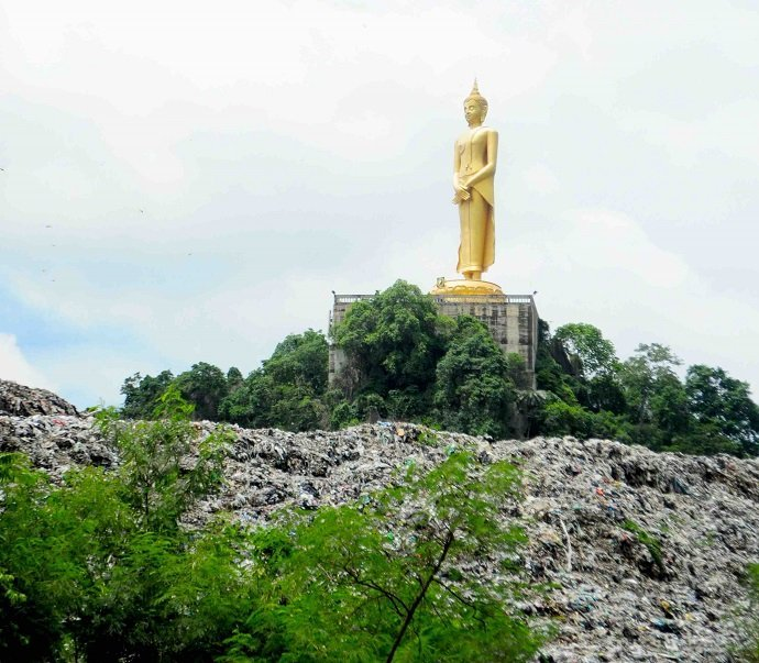 A giant golden Buddha overlooks a rubbish pile in central Thailand. Photo by David Ashwanden