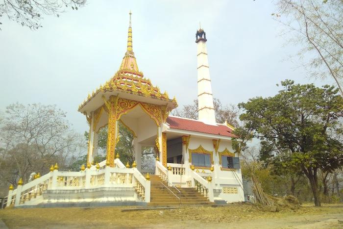 A crematorium against the seasonal haze of a Northern Thai sky. Photo by Charlotte Ashwanden