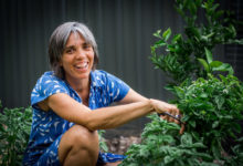 Sarah with some basil Popes Produce